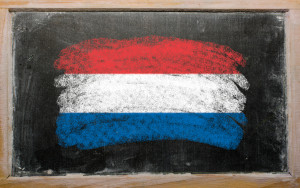 Chalky holland flag painted with color chalk on old blackboard